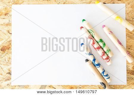 Bunch Of Thick Colorful Pencils For Children, On Blank Sheet Of Paper, On Wooden Surface