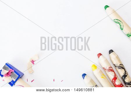 Bunch Of Thick Colorful Pencils For Children And Sharpener, On Blank Sheet Of Paper