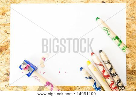 Bunch Of Thick Colorful Pencils For Children And Sharpener With Shavings, On Blank Sheet Of Paper, O