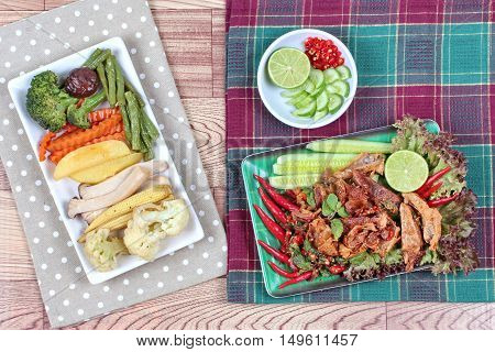 Spicy and  sour mixed herb salad with fried stir taro in tofu sheet and fried  mixed vegetables served with side dish are food for Vegetable festival of Chinese  as