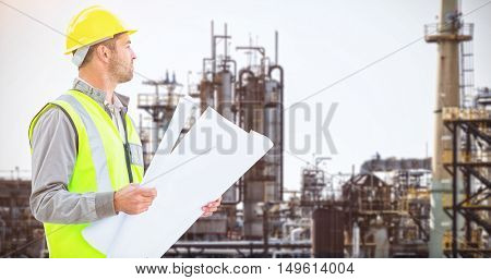 Casual architect against image of factory
