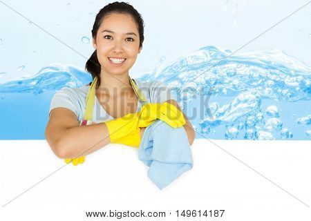 Smiling woman leaning on white surface against close up on blue sparkling water