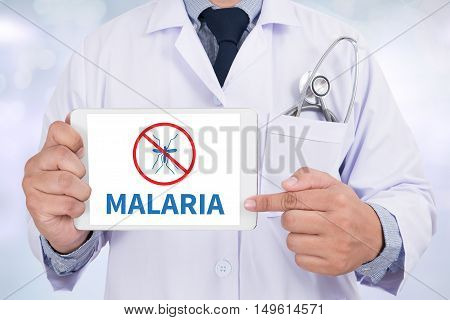 MALARIA Doctor holding digital tablet doctor work hard top view  concept