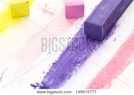 Bunch Of Square Colorful Pastel Chalks And Their Pigments, On White Background