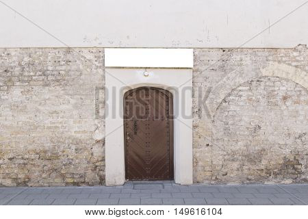 Old close brown door and grunge brick wall background