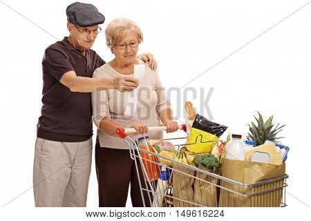 Shocked elderly couple looking at a store receipt isolated on white background