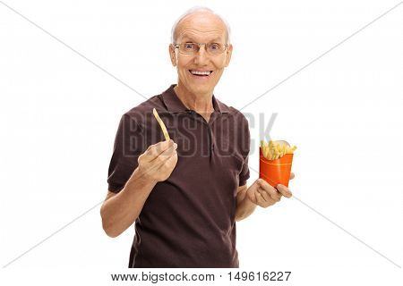 Smiling senior holding a single fry and a bag of fries isolated on white background