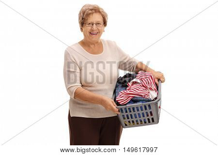 Mature woman holding a laundry basket full of clothes isolated on white background
