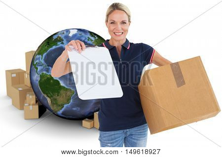 Happy delivery woman holding cardboard box and clipboard against globe surrounded by cardboard boxes