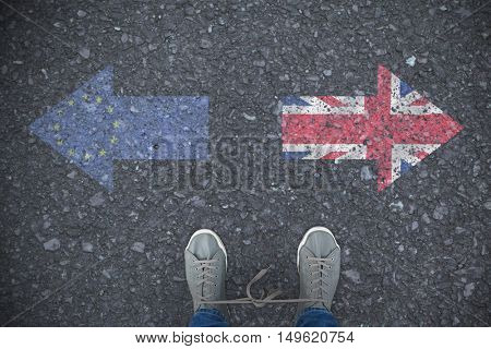 Low section of man with shoelaces tied together against close-up of european flag