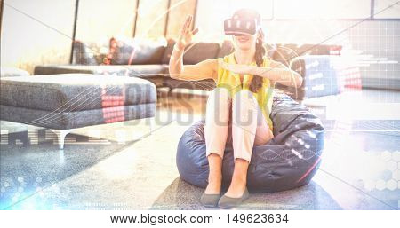 Composite image of face against woman wearing virtual reality simulator Woman wearing virtual reality simulator while gesturing at home