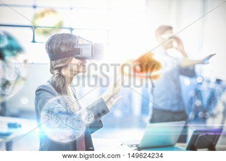 Digital image of earth against woman using virtual reality simulator