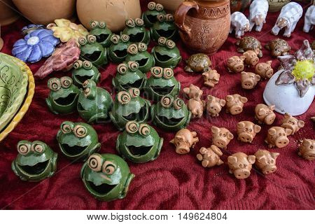 Various small figures of baked clay exposed for sale.