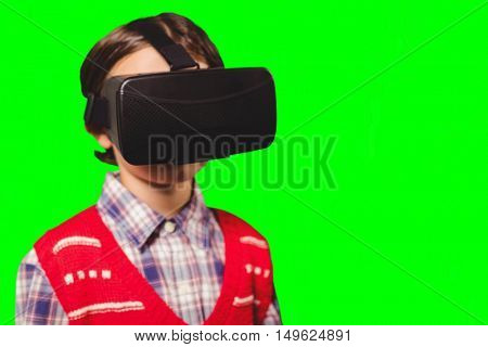 Close-up of boy wearing virtual reality simulator against green vignette