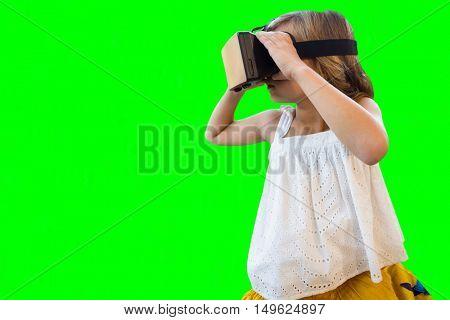 Girl wearing virtual reality simulator against green vignette
