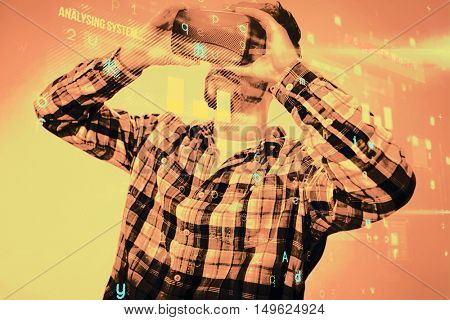 Man using an oculus against blue background