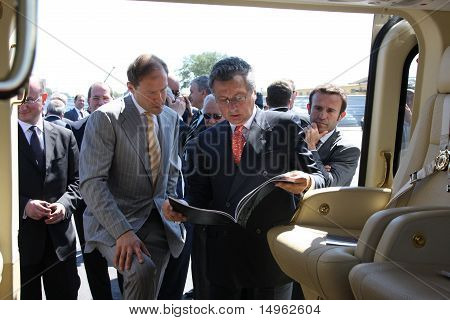 Denis Manturov And Juseppe Orsi Examine Helicopter Aw139