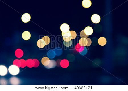 Defocused Blurred Shot of Traffic Lights Night Time bokeh Colorized Image.