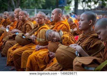 Chiang Mai, Thailand - Dec 26 2015: Young Monk Sleeping During The Traditional Buddhist Alms Giving
