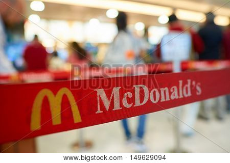 HONG KONG - CIRCA SEPTEMBER, 2016: close up shot of belt with logo of McDonald's in Hong Kong International Airport. McDonald's is the world's largest chain of hamburger fast food restaurants.