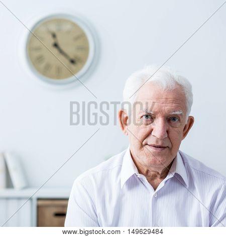 Photo of senior man wtih disability at home