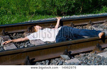 Girl Laying On A Railway