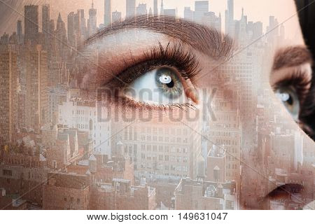 Photo of woman eye and business city. Double exposure skyscraper on the background.