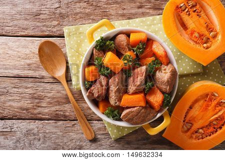 Beef Stew With Pumpkin, Onion And Spices Closeup In A Yellow Pan. Horizontal Top View