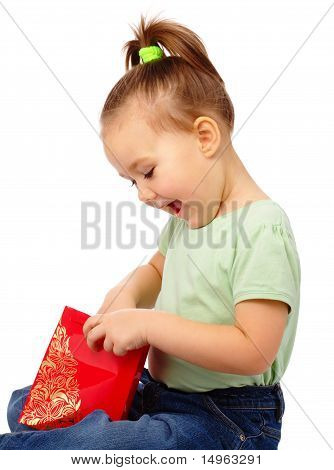 Cute Little Girl With Red Shopping Bag