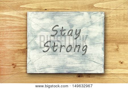 Vintage hipster motivational phrase note Stay Strong sign.