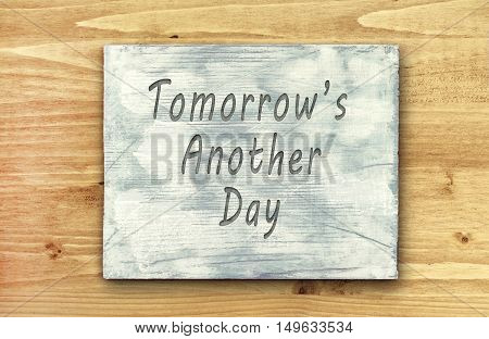 Vintage hipster motivational phrase note Tomorrows Another Day sign
