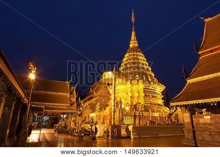 Wat Phra That Doi Suthep Golden Pagoda With Deep Blue Twilight Sky Above It. The Most Famous Buddhis