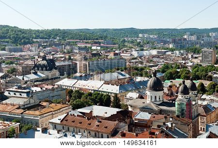 Lviv old city vintage panorama with houses roofs top view Lviv Ukraine. Retro travel industrial photo background.