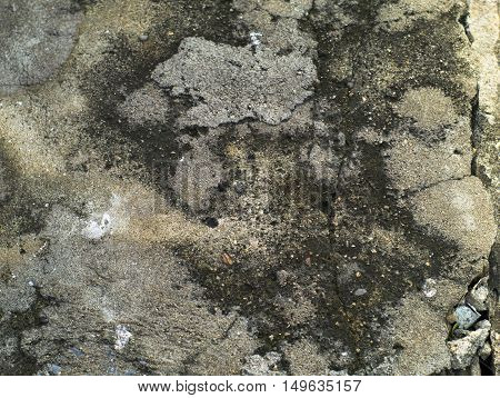 cracked and grainy concrete surface with stains