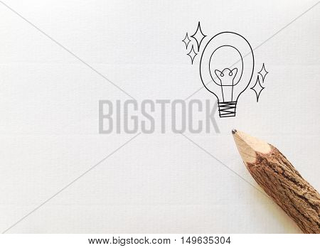 concept idea for back to school on white note paper with pencil and light bulb