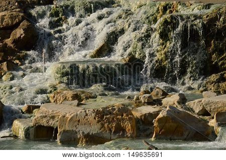 Saturnia thermal hot springs with waterfalls in Italy.