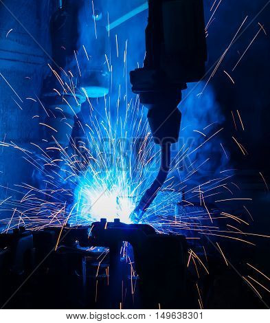 welder welding  Industrial automotive part in car production factory. closeup