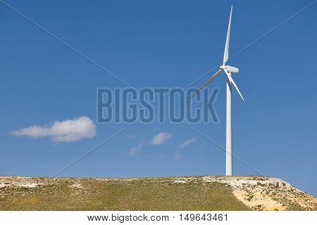 Wind turbine in the countryside. Clean alternative renewable energy. Horizontal