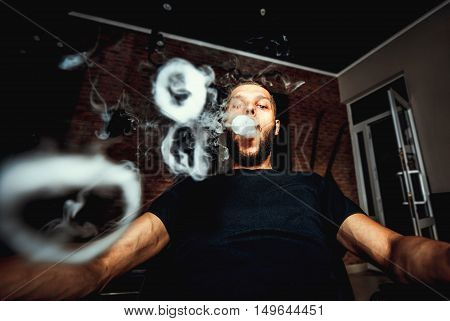 Vaper With Beard Produce Many Steam Rings