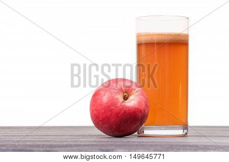 freshly squeezed Apple juice in glass with foam on the table isolated on white