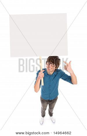Young man holding blank poster