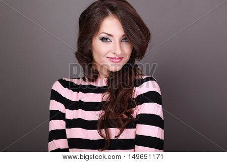 Happy Beautiful Casual Woman With Long Curly Hair Style Looking With Smile On Grey Background