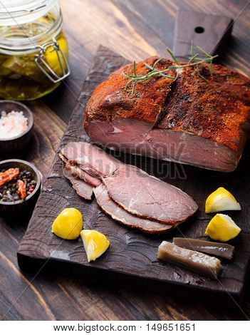 Beef pastrami sliced, roasted beef, slow cooking with marinated in olive oils eggplants on wooden board