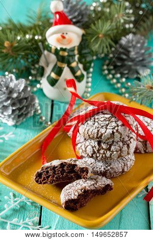 Christmas Chocolate Chip Cookies And Powdered Sugar On A Celebratory Christmas Background.