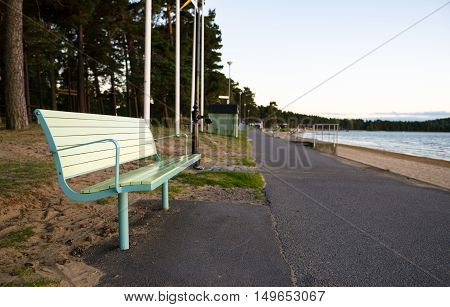 Bench by a walkway by the water