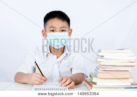 Asian Chinese Student Boy Writing With Protection Mask