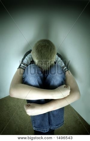 Upset Boy Against A Wall