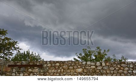 Late summer storm clouds gathering over the walls of a old derelict farmhouse in the region of Friuli in north east Italy