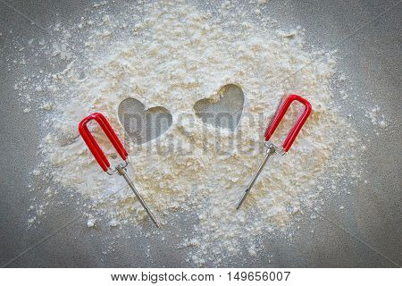 Baking concept on dark background. Baking preparation top view of variety of baking utensils with different kind of flour. Top view, with hearts