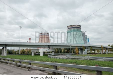 Thermal power stations and power lines on a cloudy day. Industrial landscape